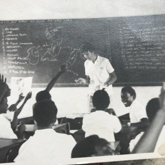 Me teaching in a classroom, the only photo I have of me from my placement